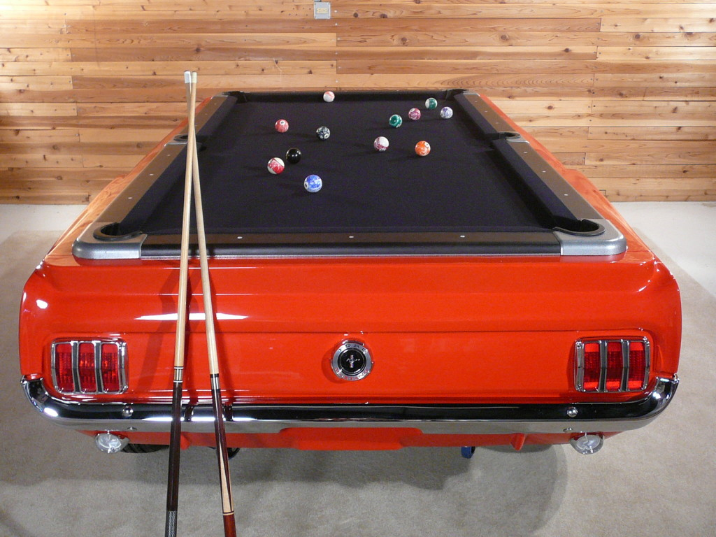 The body of the Ford Mustang pool table is molded from an actual 1965 Mustang body shell and uses genuine trim and lights.