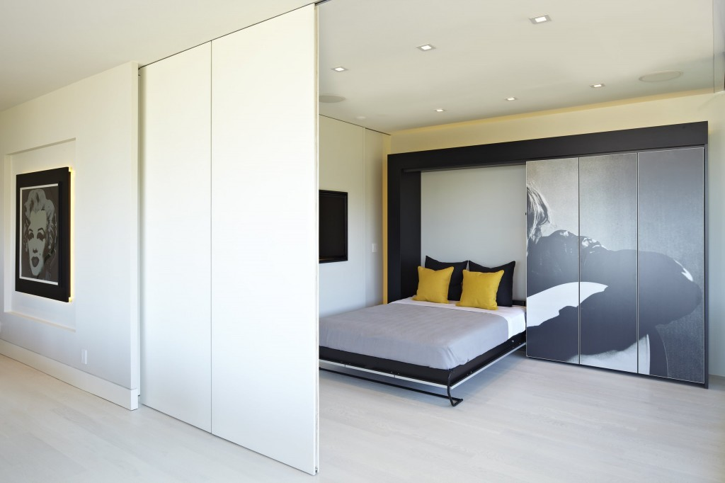 Modern-minimalist-bedroom-with-retractable-walls-design-feat-murphy-bed-on-wood-panel-flooring-and-wall-paneling-system-with-recessed-lighting-ideas-nice-closet-decal-ideas