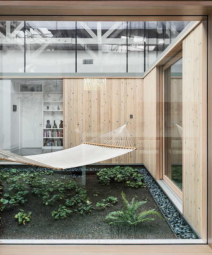 living_in_concert-portland-renovated-warehouse-bowstring-central-atrium-hammock