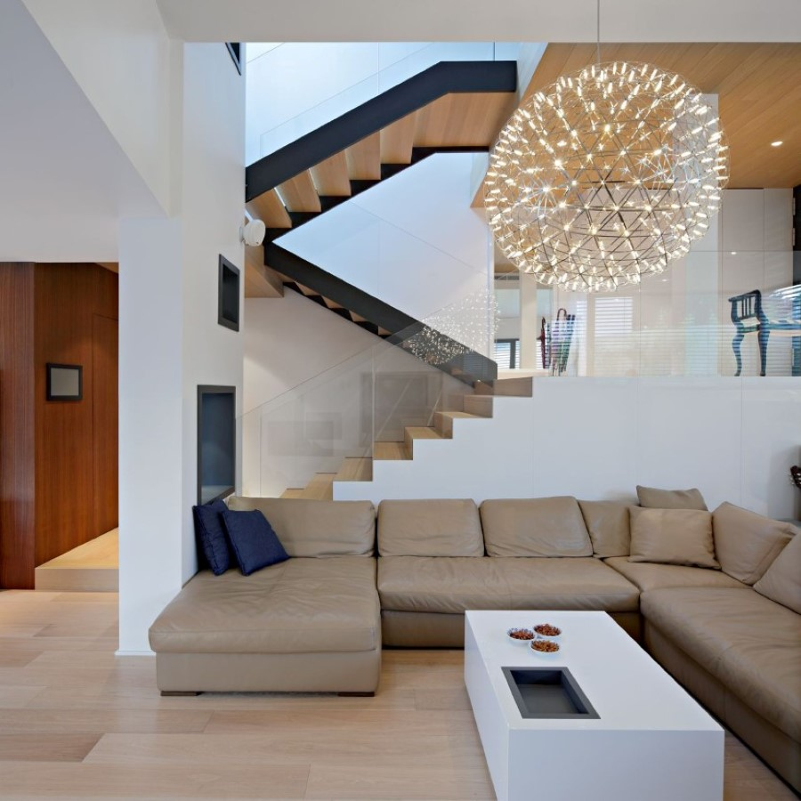 oversized-round-pendant-light-over-white-coffee-table-paired-with-brown-living-room-sectional-sofa-bed