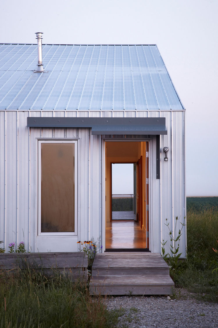 extended-treanor-residence-exterior-opened-door