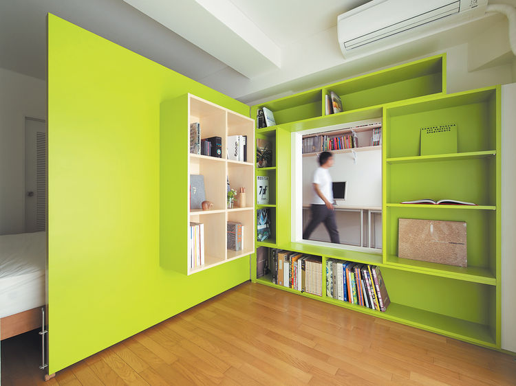 switch-apartment-plywood-door-with-built-in-bookshelves-home-office