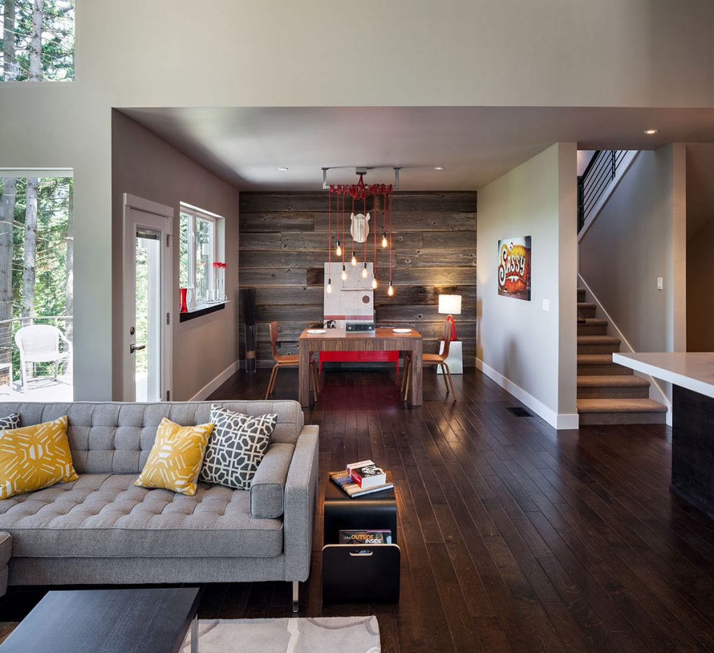 Elegant-Living-Area-with-Modern-Rustic-Decor-using-Grey-Fabric-Sofa-and-Yellow-Sofa-Pillows-above-Wooden-Floor