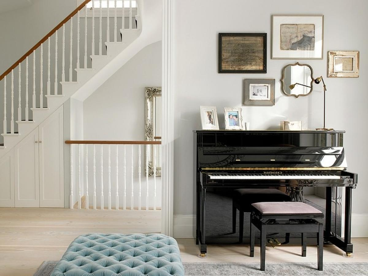 black-and-glossy-classic-piano-with-frame-at-wall-for-decoration-the-nice-place-for-playing-a-music