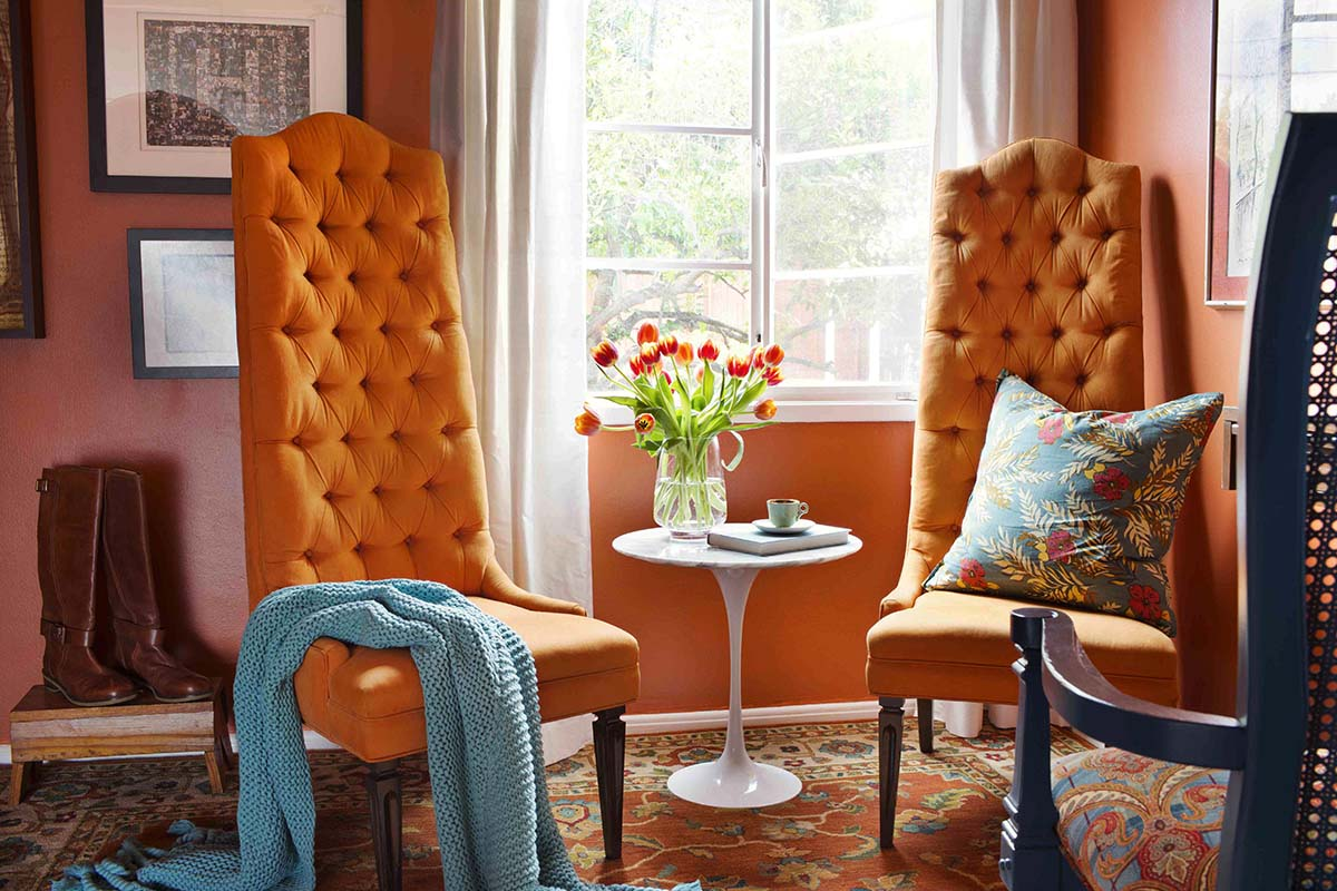 In this undated publicity photo provided by Brian Patrick Flynn, the designer, Brian Patrick Flynn, has layered several deep shades of orange throughout this space and then accented with shades of blue to create a cozy, inviting room. (AP Photo/Brian Patrick Flynn, Sarah Dorio/HGTV Remodels.com)