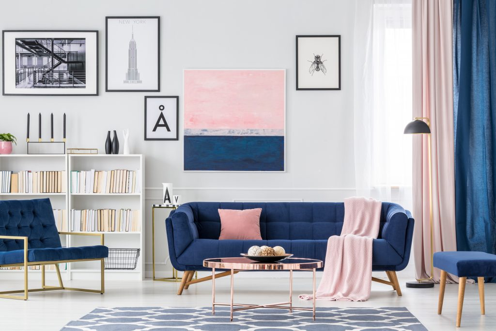 White, blue and pink living room interior with couch, paintings and curtains