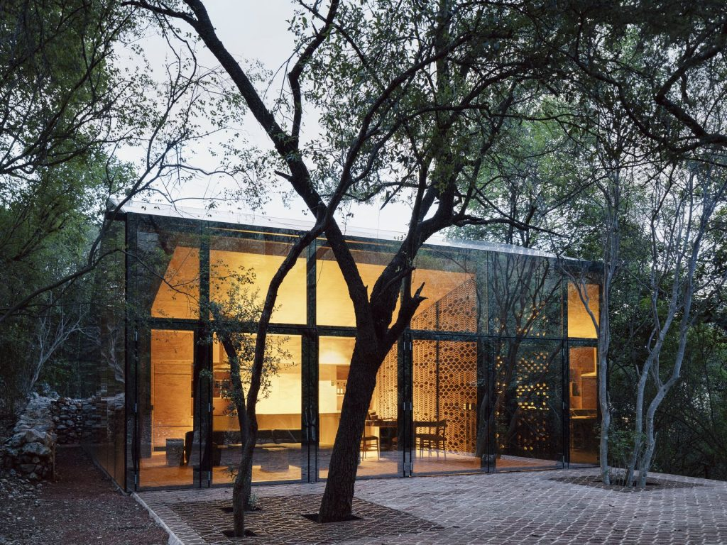 the-living-lounge-dining-and-kitchen-are-located-within-the-larger-of-the-two-volumes